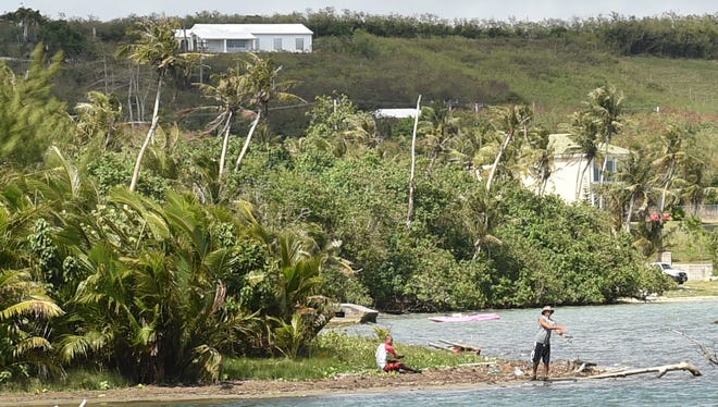 A fisherman casts his line into the mouth of the Pago River in Yona on Mar. 1, adjacent to the land where residential towers with approximately 300 units are proposed. Also on Mar. 1, a public hearing relative to the Southern Development Master Plan was held at the Guam Legislature.