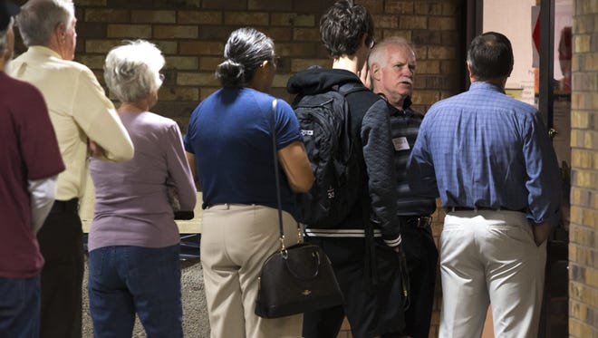 Voters wait in line, March 22, 2016, at the Pyle Adult Recreation Center, 655 E Southern Ave., Tempe. The polls were open from 6 a.m. to 7 p.m.