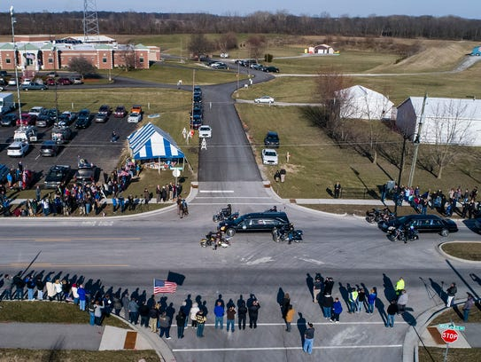 The hearse carrying fallen Boone County Deputy Jacob