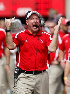 Nebraska Cornhuskers coach Bo Pelini tries to call a timeout against the UCLA Bruins in the fourth quarter at Memorial Stadium. UCLA won 41-21.