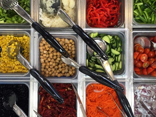 A look at the salad and wrap toppings at Crisp Greens,