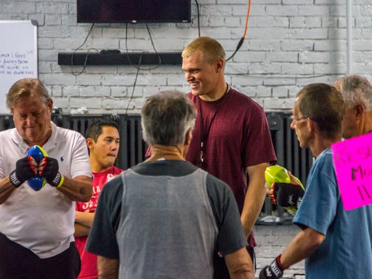 Jens Howe leads the Rock Steady Boxing class for people
