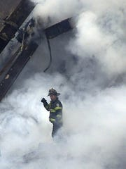 New York City firefighters continue to work in the burning rubble as they search for victims at the World Trade Center on Friday morning   .....(Frank Becerra  Jr./ The Journal News 9/14/2001 )