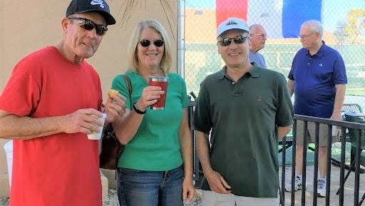 Alto Lakes Tennis Association members pay homage to the French Open by staging their own tournament at the Alto Lakes Golf and Country Club, where they snacked on French delicacies.