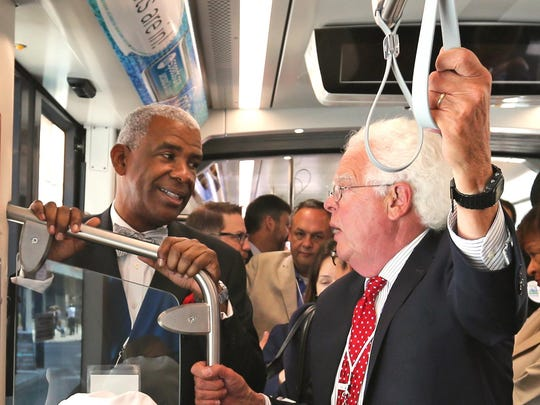 Dwight Ferrell, Cincinnati Metro CEO, left, and Cincinnati City Councilman David Mann ride the Cincinnati Bell Connector during the streetcar's opening day in 2016. Metro oversees the streetcar, which is owned by the city.
