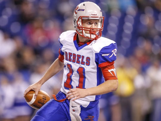 Roncalli quarterback Derek O'Connor (11) led the Rebels to the Class 4A state title in November.