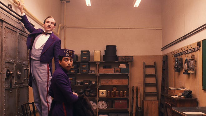 Ralph Fiennes, left, and Tony Revolori anchor the latest from director Wes Anderson, the caper comedy 'The Grand Budapest Hotel.'