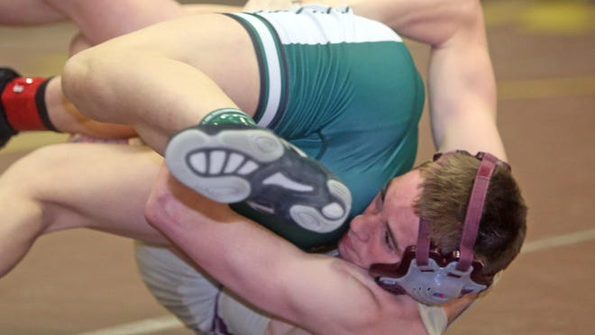 Arlington High School's Brady Robin defeats Brewster's Grant Cuomo, 2-1, to win the 138-pound Section 1 Division I title at Clarkstown South High School on Sunday.