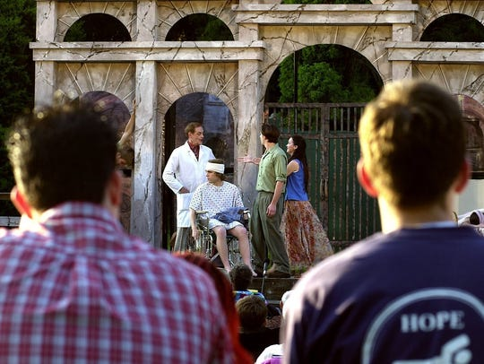 """An audience watches the production of """"Chaucer in Rome"""""""