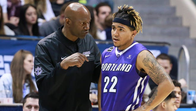 Portland Pilots guard Jazz Johnson, shown talking with coach Terry Porter last season, will transfer to Nevada.