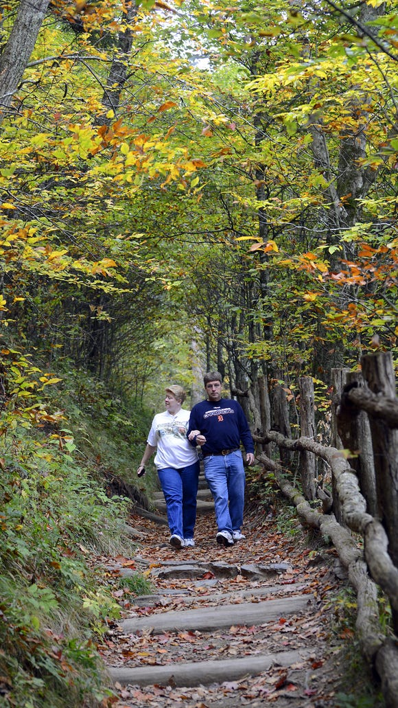 Hikers enjoy a trail in Great Smoky Mountains National Park. Rangers offer free guided hikes on Black Friday.