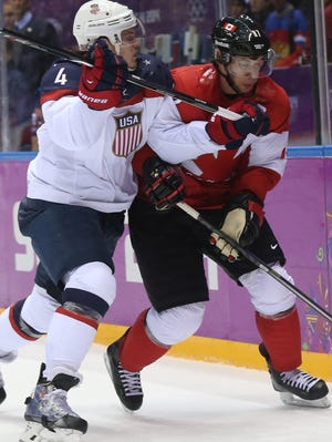 Sidney Crosby (right), whose goal gave Canada the gold medal in 2010, is on the verge of a repeat. Canada meets Sweden on Sunday.