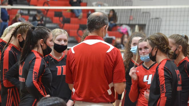 Onaway players listen to head coach Steve Watson during a varsity volleyball match against Bellaire on Tuesday, Oct. 13. The Cardinals claimed the Presque Isle County championship with wins over Posen and Rogers City on Wednesday.
