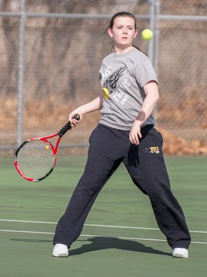 Pennfield singles player Lisa Dube during competition earlier this season. Pennfield will be competing in the All-City tennis tourney on Saturday.