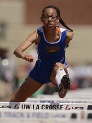 Sheboygan North's Monique Felix clears a hurdle while competing in the Division 1 100-meter hurdles during Saturday's WIAA state track and field meet at Veterans Memorial Stadium Complex in La Crosse.