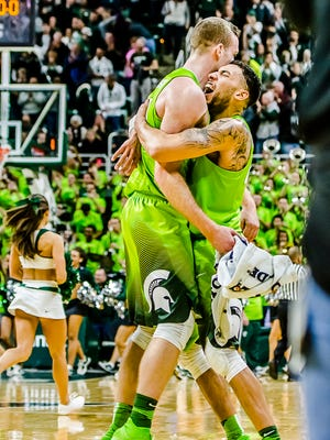 Denzel Valentine, right, of MSU hugs teammate Matt Costello after their win over Maryland.