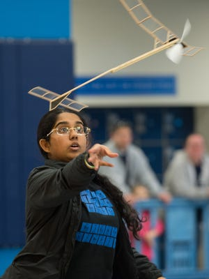 Santoshi Kandula a junior at Newark Charter School releases her flying machine to compete in the Wright Stuff event at the High School Division Science Olympiad Competition at Delaware State University.