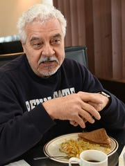 Larry Steele pauses during lunch at Flamingo Restaurant