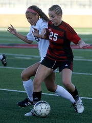 Wichita Falls High School's Emma Antill works against Grapevine's Audrey Alderink Friday, March 31, 2017, in Mineral Wells for the Region I-5A area playoff. The Mustangs defeated the Coyotes on penalty kicks 7-6.