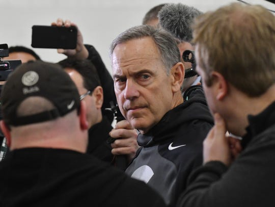 MSU football coach Mark Dantonio talks with media before a spring practice in East Lansing.