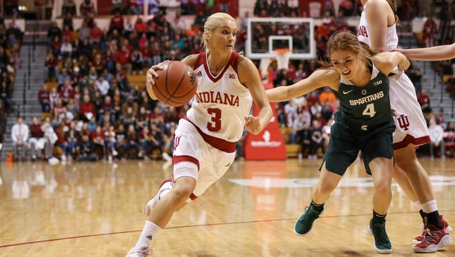Tyra Buss, driving against Michigan State, is 14 points shy of becoming IU's career scoring leader.