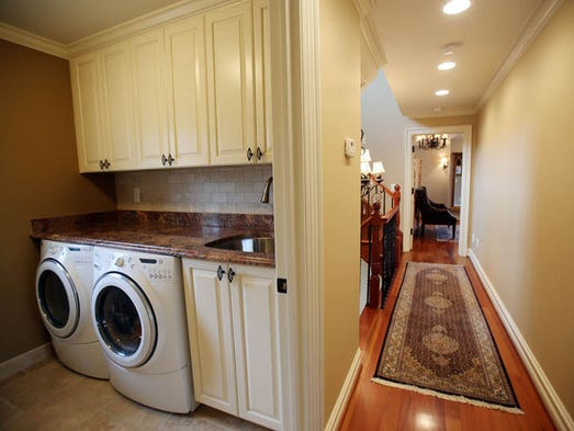 Meet this new york style brownstone tucked into birmingham for Second floor laundry