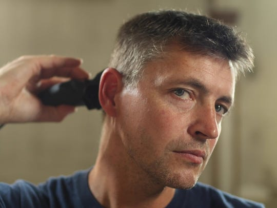 York firefighter Ivan Flanscha uses a Wahl hair clipper