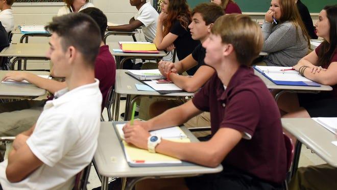 Forrest County Agricultural High School juniors sit through their math class.