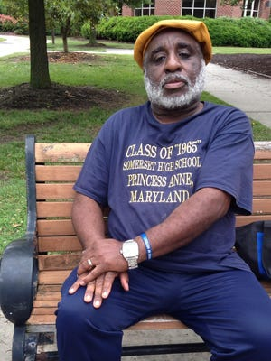 George Tilghman, a member of the Somerset High School Class of 1965, sits on a bench outside Kiah Hall on the University of Maryland Eastern Shore campus. Kiah served black high students in the Princess Anne-area between 1954 and 1969. The class plans to place new and engraved benches at the building to mark its historical significance.