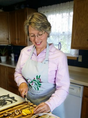 """Angela Dailey, a licensed clinical social worker with a practice in Fairfield, believes so deeply in the link between nutrition and depression that she wrote a book about it, """"Cooking to Cure."""""""