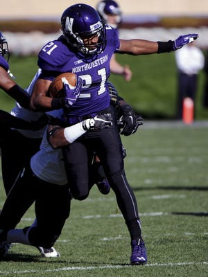 Northwestern running back Justin Jackson is tackled by Purdue cornerback Anthony Brown during the first half.