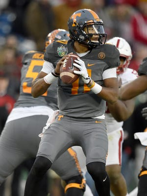 Tennessee Volunteers quarterback Joshua Dobbs (11) drops back during the second half of the Franklin American Mortgage Music City Bowl at Nissan Stadium in Nashville, Tenn., Friday, Dec. 30, 2016.