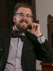 Mitchell Frizzell wears a double-breast-pocketed Calvin Klein sport coat with lilac Brooks Brothers Oxford shirt, a black owl bow tie from the Tie Bar, fern green Gap slacks, a Perry Ellis pin-buckle belt, and Stacy Adams black leather square-toed shoes. He's seen at Christ Church Christiana Hundred, where he is a choir member.