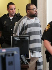 Glen Bates, charged with murder in the death of his 2-year-old daughter, Glenara, enters a Hamilton County courtroom Monday for an arraignment.