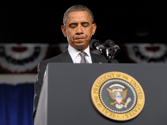 President Obama pauses as he speaks about the Aurora,