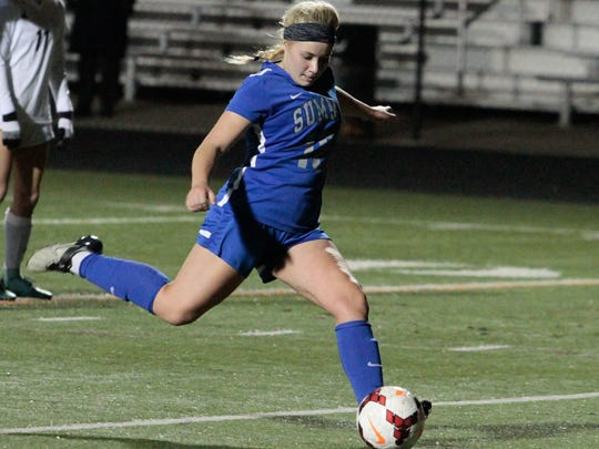 Maddie Brault of Summit takes a penalty kick to tie