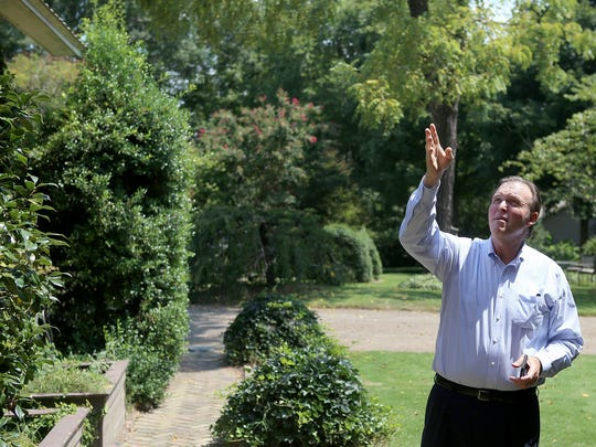 Rex Leatherwood discusses the exterior of the W.K. Walsh House Aug. 28 in Jackson.