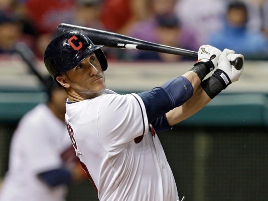 Cleveland Indians' Yan Gomes watches his RBI double in the seventh inning of a baseball game against the Cincinnati Reds Tuesday, Aug. 5, 2014, in Cleveland. (AP Photo/Mark Duncan)