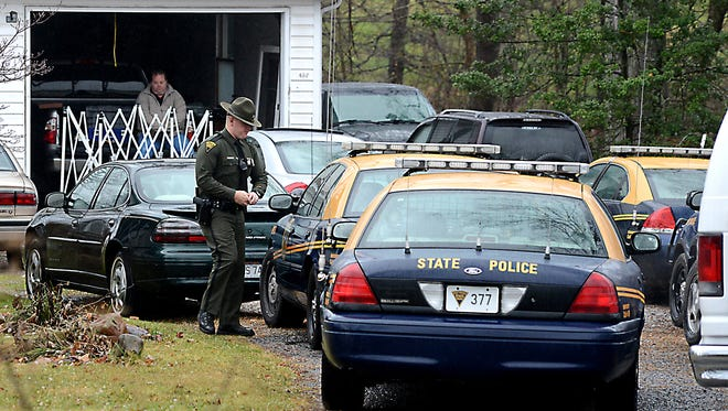 State police gather at at residence in Cheat Lake, W.Va., area where two of four shooting victims were found.