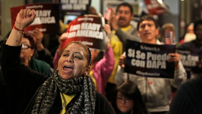 Mercedes Herrera and others chant during an event on DACA and DAPA immigration relief at the Houston International Trade Center on Feb. 17, 2015, in Houston.