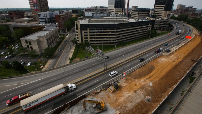 An overview from the Jewish Hospital Office Building of the current construction just west of the far right lane of I-65 South, where a new parallel road is being built from Witherspoon St. to Muhammad Ali Blvd. May 8, 2014