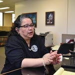 In this file photo, Guam Election Commission Executive Director Maria Pangelinan discusses online voter registration at the Guam Election Commission Office.