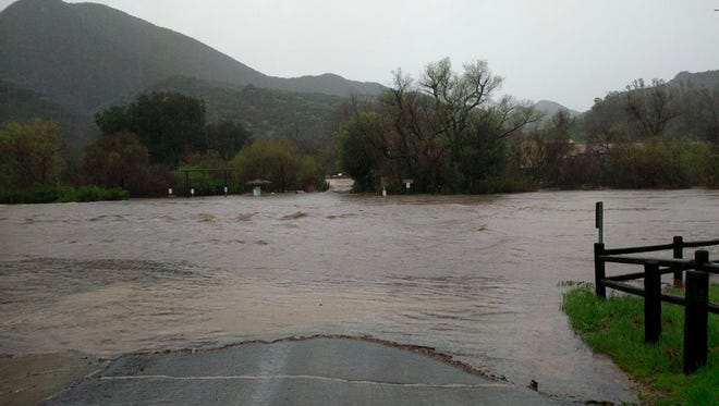 The parking lot at Paramount Ranch in Agoura Hills flooded Friday after a nearby creek breached its banks.