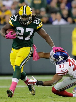 Green Bay Packers running back Eddie Lacy runs for a first down against New York Giants safety Andrew Adams in the second quarter at Lambeau Field.