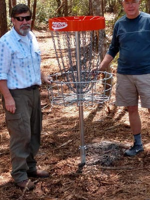 Sneads Ferry Rotary Club's Disk Golf Course located at Stump Sound Park will hold its official opening at 2 p.m. June 27. Pictured is Dan Wingate and Rotary President-Elect, Phil Work.