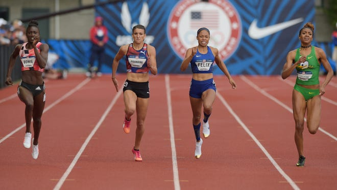 Winner Tori Bowie (left), third-place Jenna Prandini (second from left) and second place Deajah Stevens (far right) sprint down the stretch in the 200. Allyson Felix finished fourth.