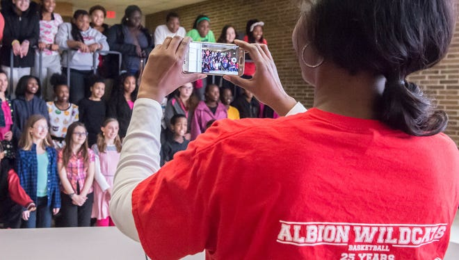 In this January 2016 photo, Albion Public Schools social worker Alycia Williams-Marshall takes a picture of Albion students set to attend other schools the following semester. Marshall Public Schools annexed the Albion district last year.