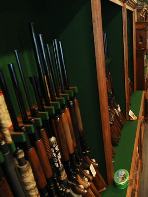 A display case at Artemis Outfitters in Greenville. In July, 27 assorted handguns were stolen from the store.