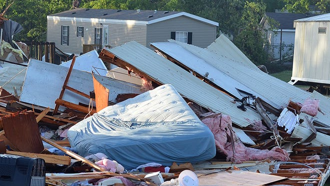 Storm damage at a mobile home park in Pearl, Miss.