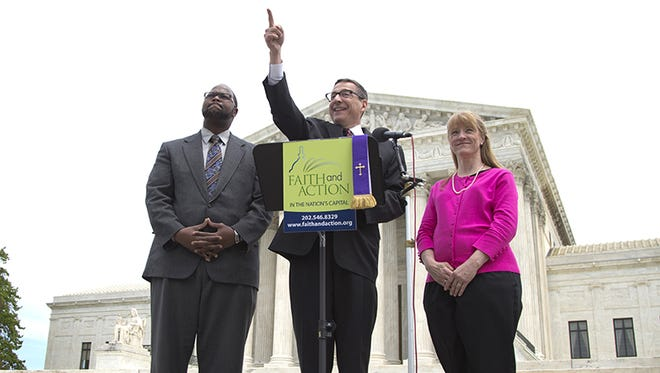 Rev. Dr. Rob Schenck, of Faith and Action, center, speaks in front of the Supreme Court with Raymond Moore, left, and Patty Bills, both also of Faith and Action, during a news conference, Monday, May 5, 2014, in Washington, in favor of the ruling by the court's conservative majority that was a victory for the town of Greece, N.Y., outside of Rochester. A narrowly divided Supreme Court upheld decidedly Christian prayers at the start of local council meetings on Monday, declaring them in line with long national traditions though the country has grown more religiously diverse. (AP Photo/Carolyn Kaster)